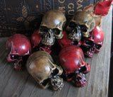 set of 6 aged bone and red skull pins