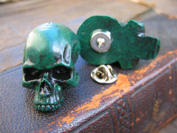 green skull lapel pin