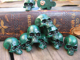 many green skull lapel pins