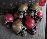 red and aged bone skull lapel pins