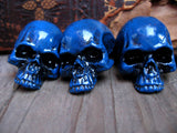 3 blue colored skull pin