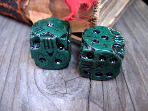 green skull stone cast dice