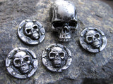 5 silver colored skull pins