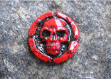 red skull lapel pin