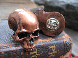 copper colored skull pin