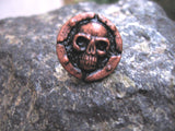 copper color skull lapel pin