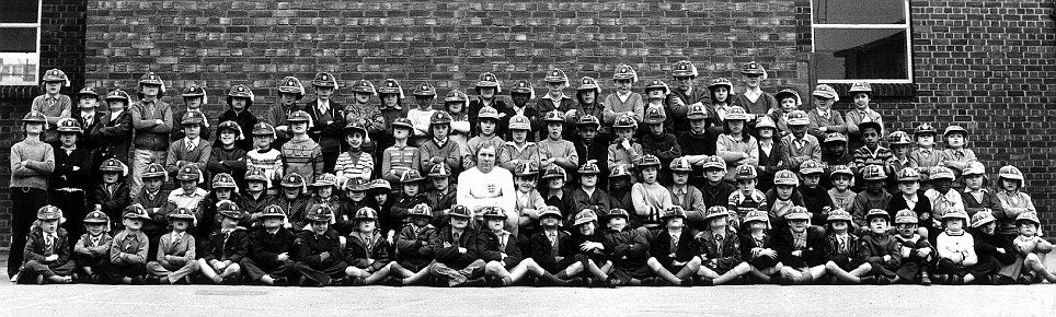 Bobby Moore  |  England  |  Posing with 99 schoolboys on the eve of his 100th cap