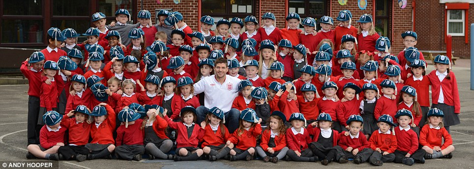 Steven Gerrard  |  England  |  Posing with 99 schoolboys on the eve of his 100th cap, 2012