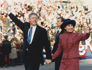 Bill Clinton and Hillary Clinton waving and holding hands at the 1993 presidential inauguration