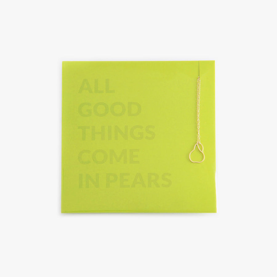 A minimalist pear charm on a gold-filled necklace by Talia Sari, because you know all good things come in pears...