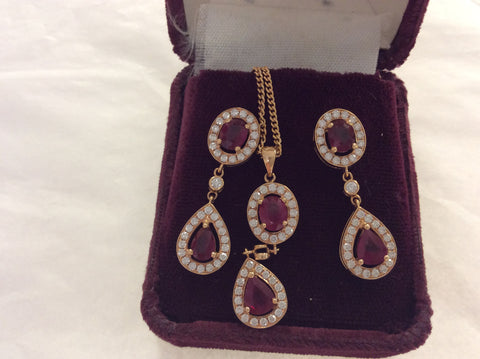 18 k gold , ruby & diamond drop earrings & pendant