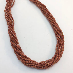 Goldstone - Round faceted 2mm