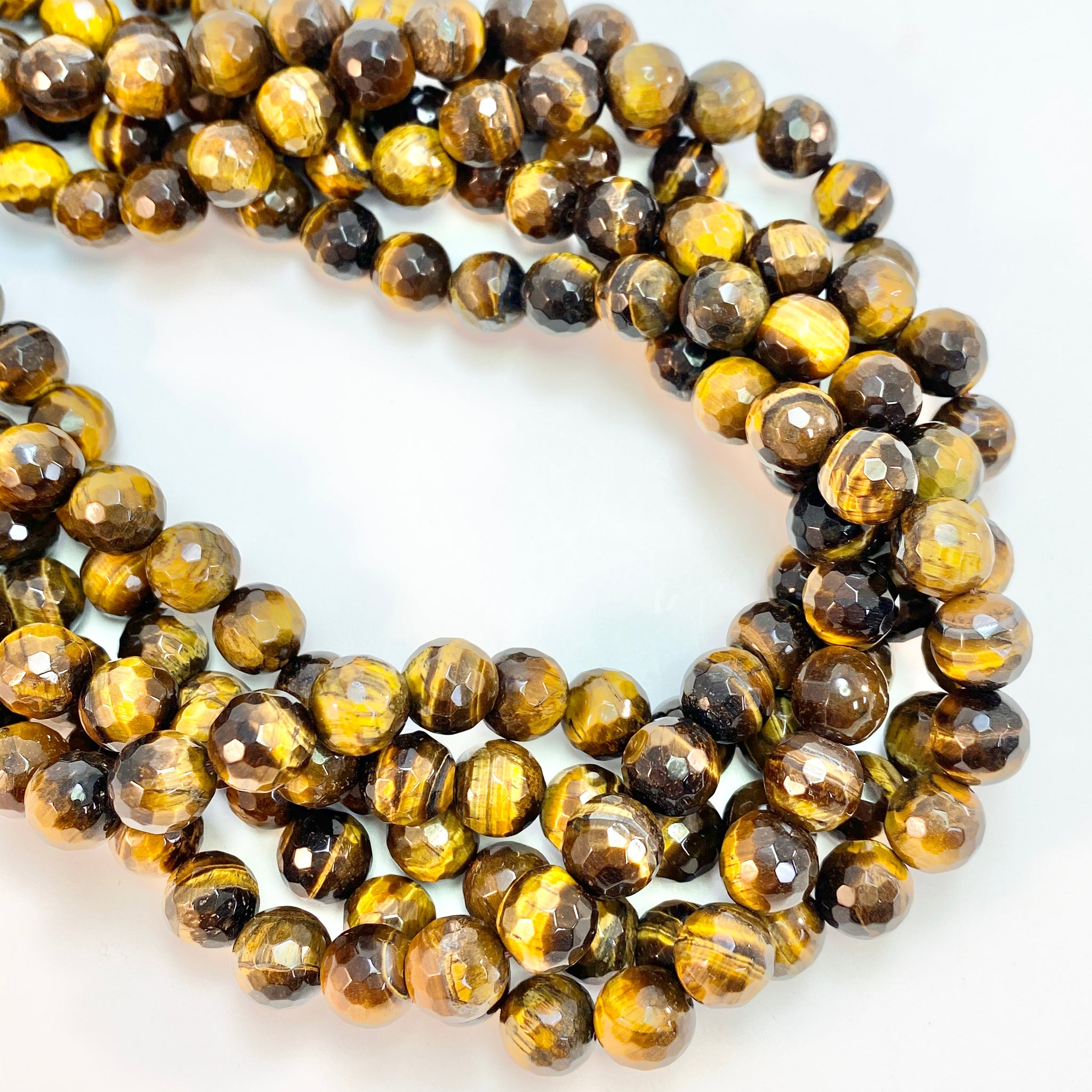 Tiger Eye - 10mm round, faceted