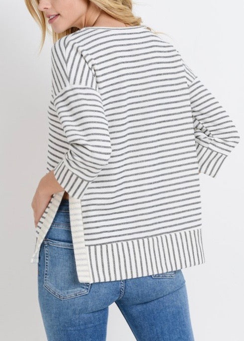 Three quarter off the shoulder sleeves with high-lo hems
