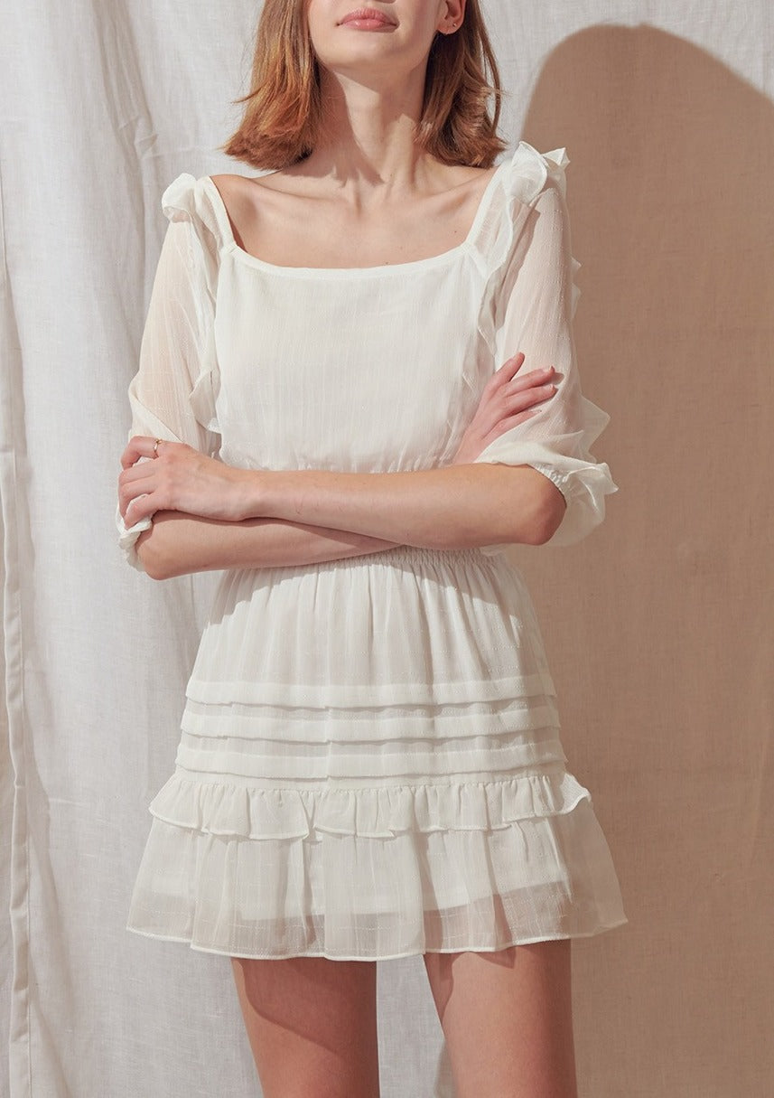 solid white ruffled mini dress