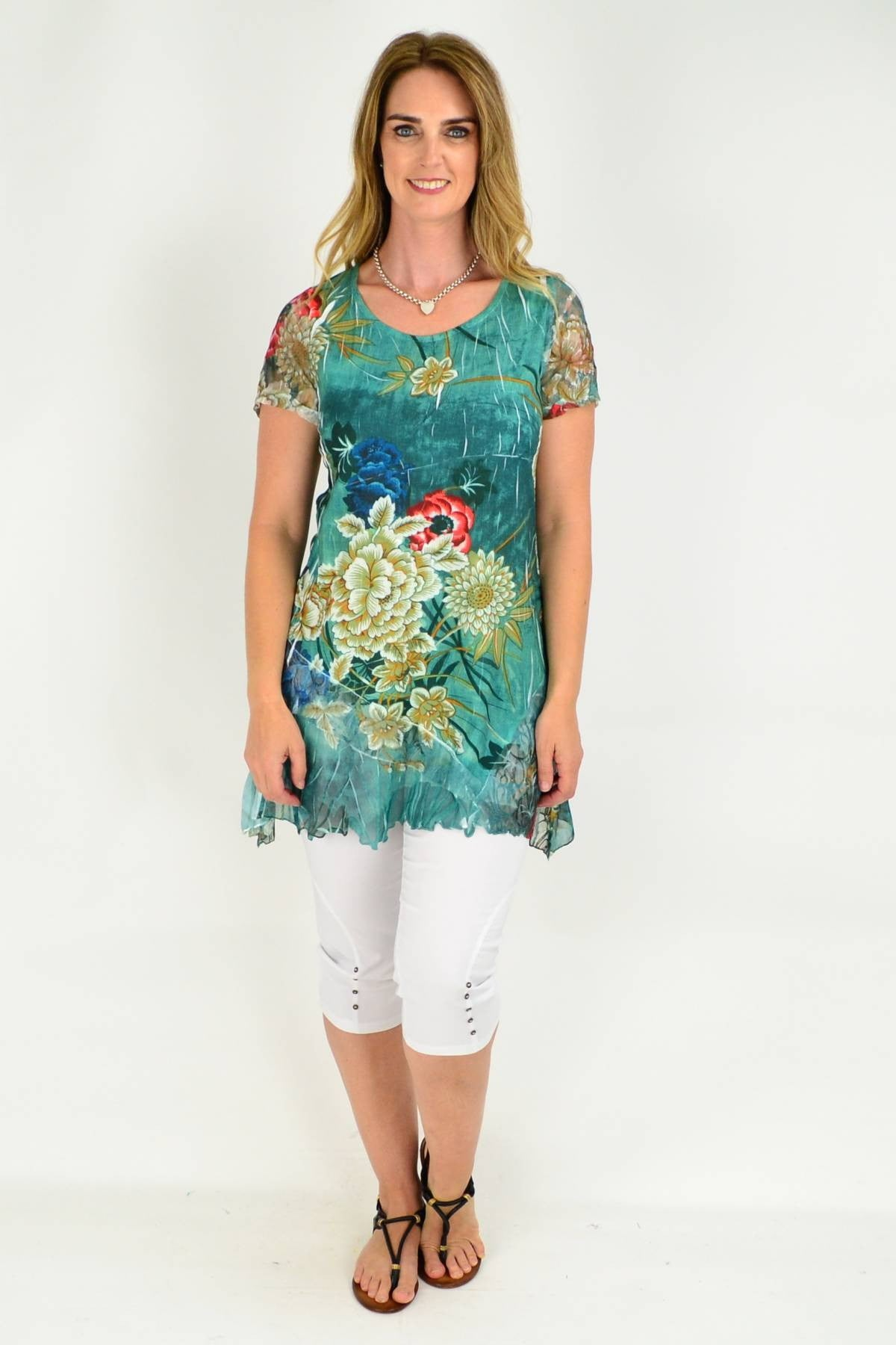 model wearing david jessie green floral tunic top