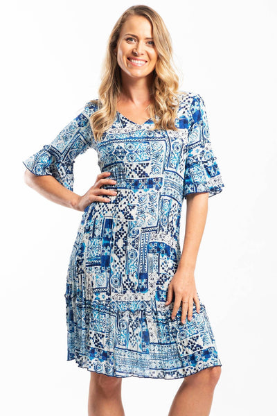 Model wearing blue white summer dress by orientique australia
