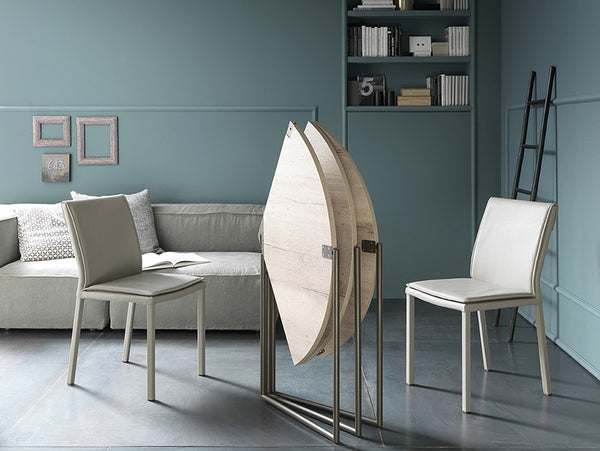 Icaro round transforming table by Altacom Italia