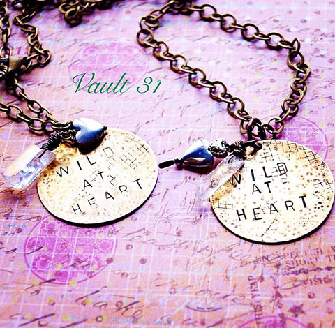 Hand stamped metal disc necklace