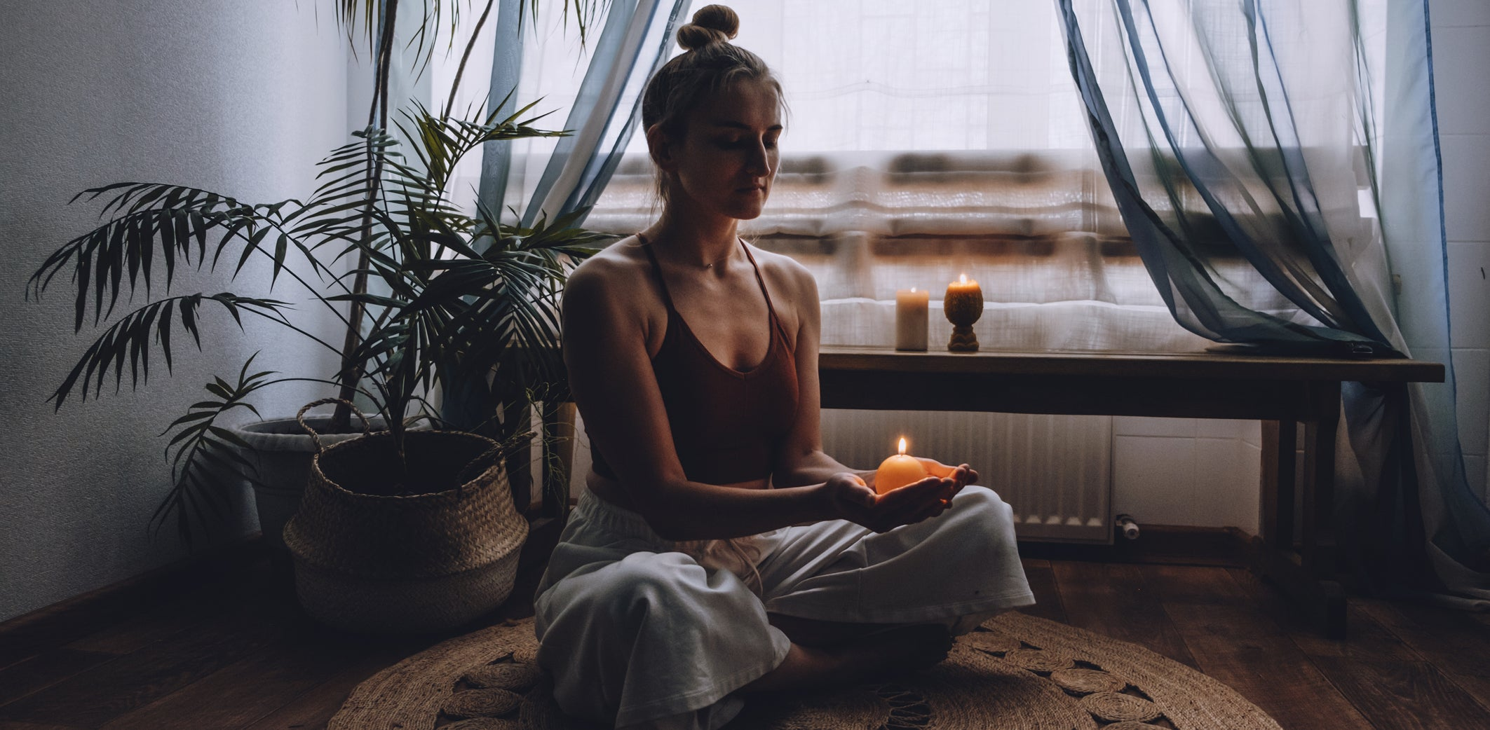 Easy Self Care - Daily Routines - women meditating candles