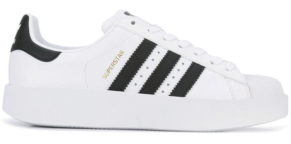 Adidas originals superstar white and black sneakers featured in Capsule wardrobe on ownmuse.com