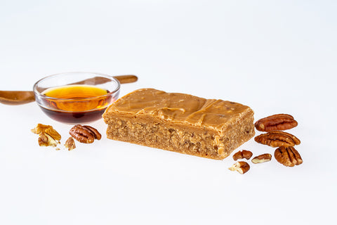 Blog of Ochil Fudge Pantry Fudge surrounded by pecan nuts and a clear bowl filled with maple syrup