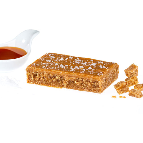 Block of Ochil Fudge Salted Caramel surrounded by fudge pieces and caramel sauce