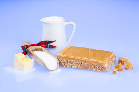 Scottish Tablet surrounded by Butter, Sugar and Milk