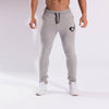 Joggers from Gymgator mens gym gear: grey, slim fit, cuffed bottom, embroidered logo and zip pockets