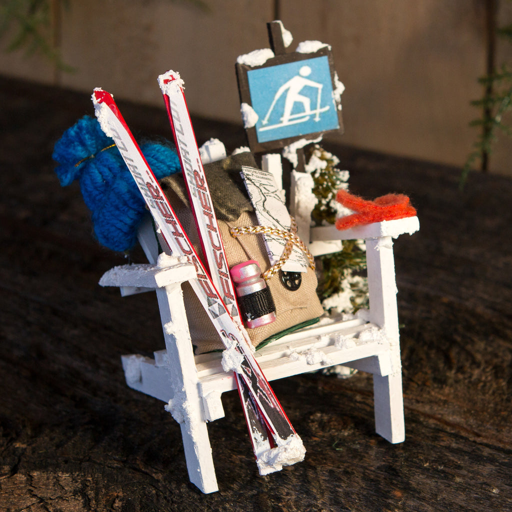A mini Adirondack ski themed chair.