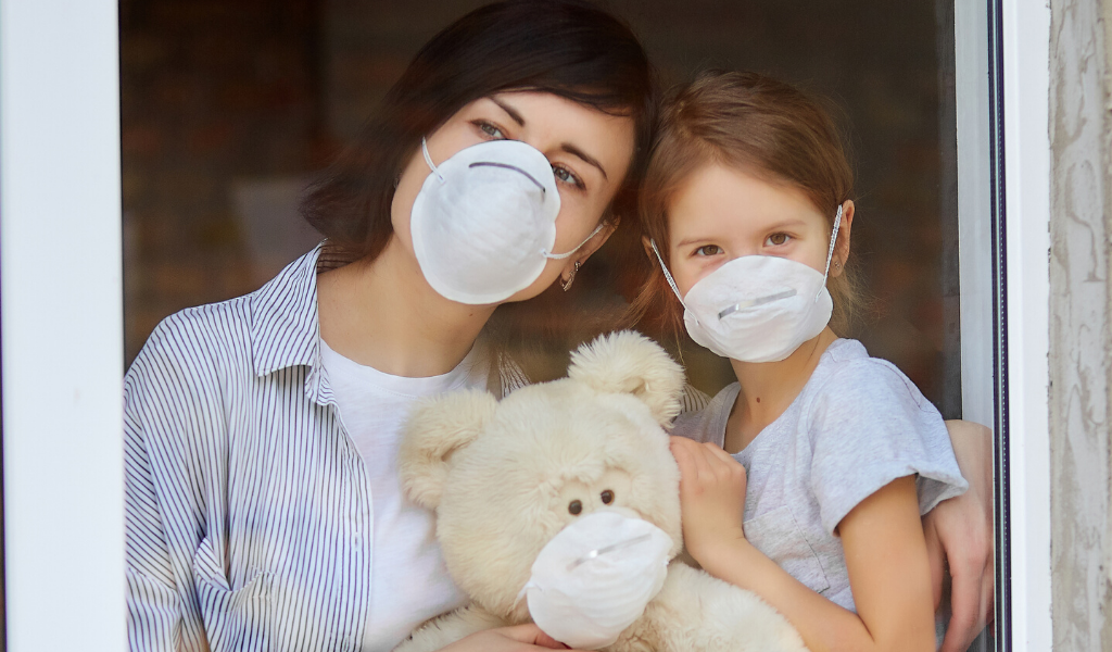 Mother and Daughter both wearing face masks