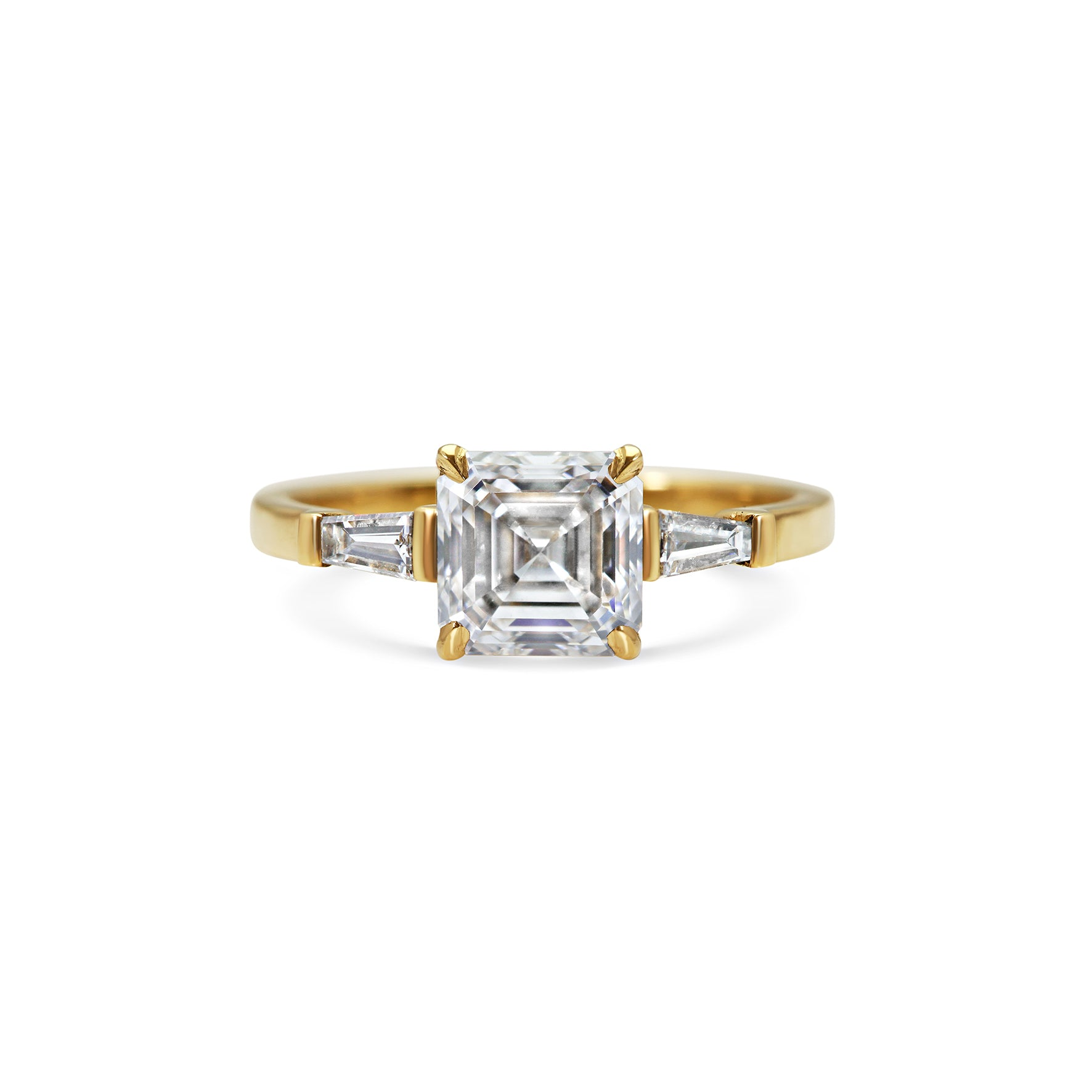 Asscher diamond and tapered baguette diamonds yellow gold