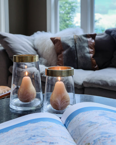 candles and interior design of a Stowe Kitchen Bath & Linens living room