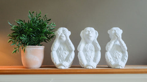 monkey statues in a Stowe Kitchen Bath & Linens living room