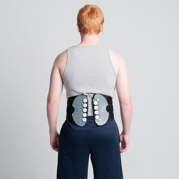 man in Vertebral Brace - back view