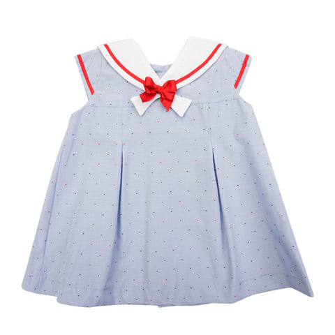 The absolute classic for this summer, sailors girl dress romper in a light blue fabric dotted in red and blue embroidery. White sailor collar and little bow detail in red. Buttoned at the back and fully lined for comfort.      MACHINE WASHING MAX 30°C / 85ºF SHORT SPIN DRY DO NOT BLEACH IRONING MAX 110°C / 230ºF DO NOT DRY CLEAN DO NOT TUMBLE DRY front