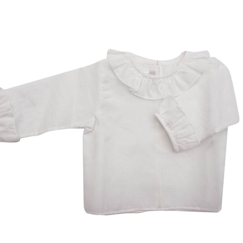 Delicate baby shirt with frill collar and sleeves. One button at the back to keep baby fresh and comfortable in the warmer days. Ideal also to layer out with our hand knitted cardigans. 100% Cotton.   MACHINE WASHING MAX 30°C / 85ºF SHORT SPIN DRY DO NOT BLEACH IRONING MAX 110°C / 230ºF DO NOT DRY CLEAN DO NOT TUMBLE DRY front