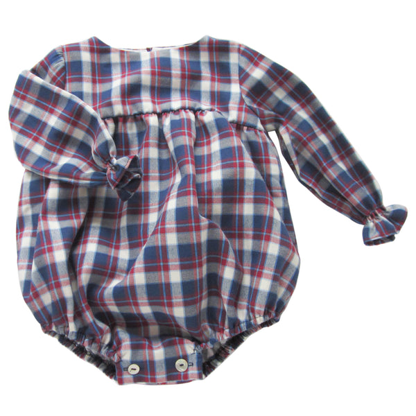 This adorable plaid romper is perfect to layer up in colder days with a collar shirt underneath. Long sleeves with an elastic finish. Three wooden buttons at the back. 50% cotton - 50% polyester, fully lined with 100% cotton. Matching shirt available for older brothers. made in spain. machine wash. front