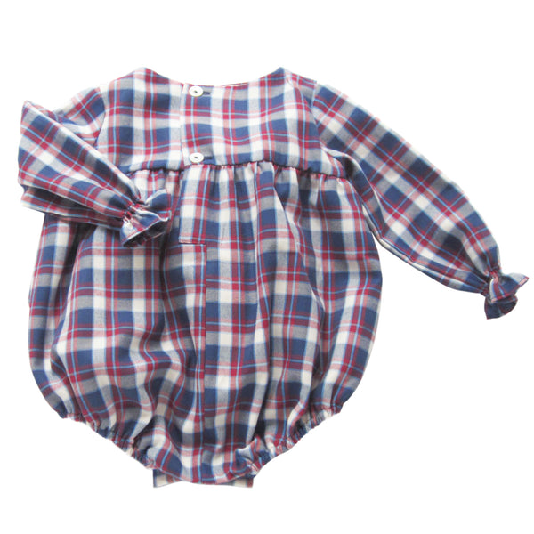 This adorable plaid romper is perfect to layer up in colder days with a collar shirt underneath. Long sleeves with an elastic finish. Three wooden buttons at the back. 50% cotton - 50% polyester, fully lined with 100% cotton. Matching shirt available for older brothers. made in spain. machine wash. back
