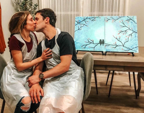 Couple Kissing After Painting Date Night