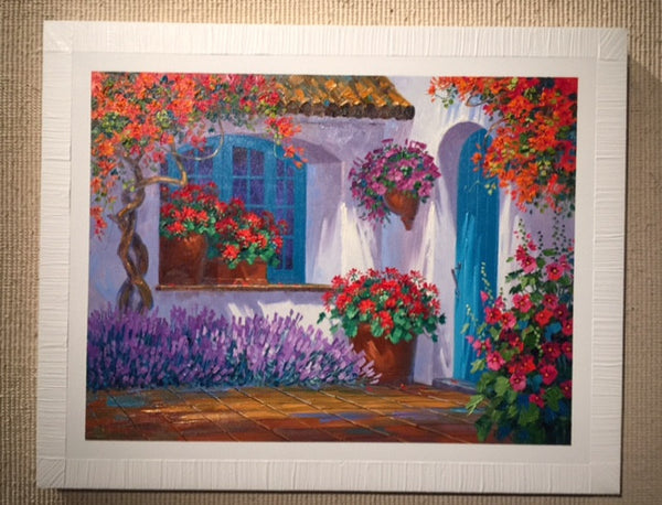 Renowned artist Mikki Senkarik creates a World of Happiness with the original oil painting Floral Embrace.  This painting features a courtyard with vibrant flowers, and an inviting turquoise door.  What's beyond the door?
