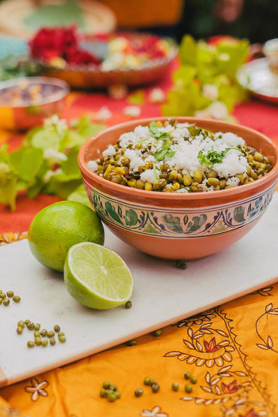 Moong Salad in bowl with lime wedges