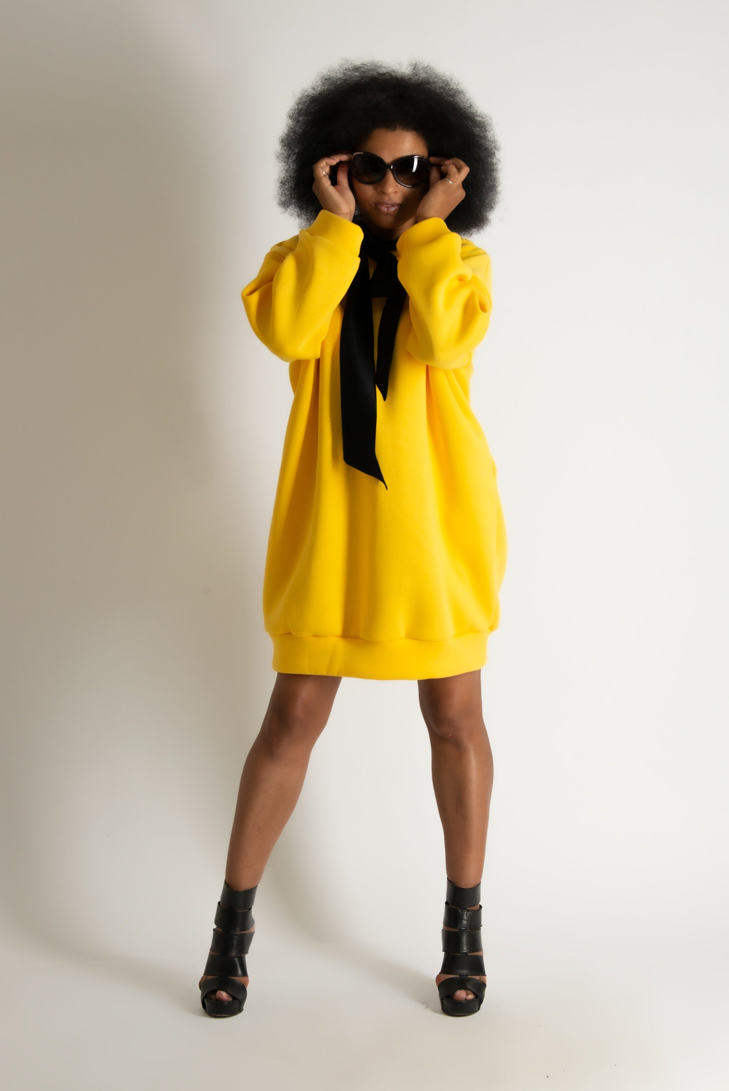 Yellow hooded dress