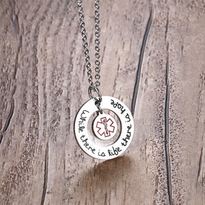 "Stainless Steel Medical Sign Jewelry Necklace - ""While there is life there is hope"""