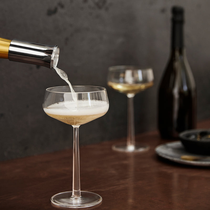 champagne pourer into glass
