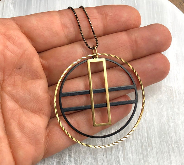 Black and Gold Geometric Medallion Necklace