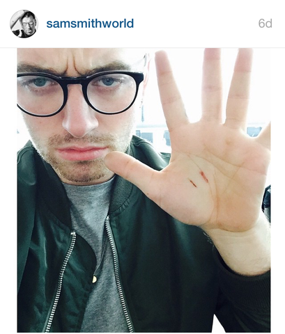 Sam Smith Wearing the 'Initial Coin Necklace' in Silver, by Laura Lee Jewellery
