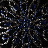 Blue Sapphire and Diamond Swirl Flower Pendant