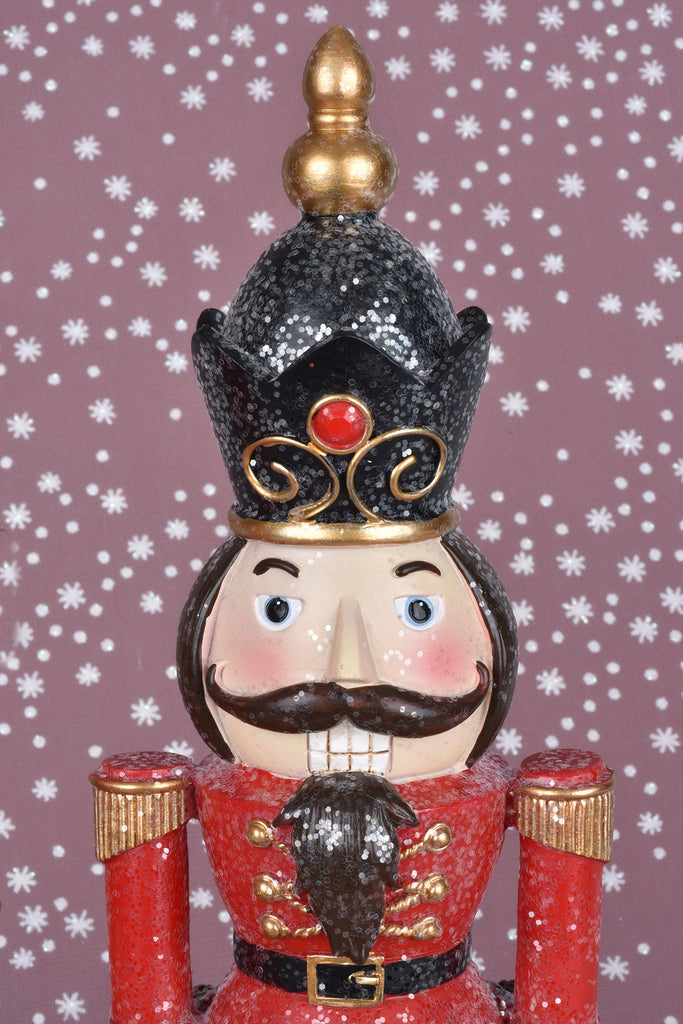 Set of 2 Glittered Nutcrackers on Black Pedestals