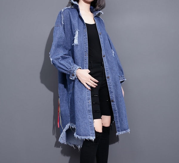 Slay Accessories. Distressed long denim shirt jacket with graphic detailing.